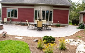 landscaping done by tree top nursery in the backyard patio of a home